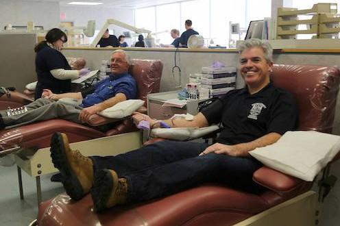 Suffolk County Executive Steve Bellone, right, and Comptroller Joseph Kennedy donated blood Jan 28 at a blood donation center in Bohemia.